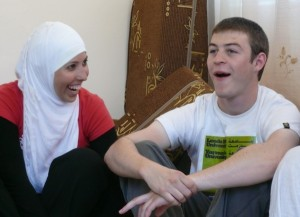 The author (right) and Dima share a joke over lunch in a family home in Orjan village, Jordan